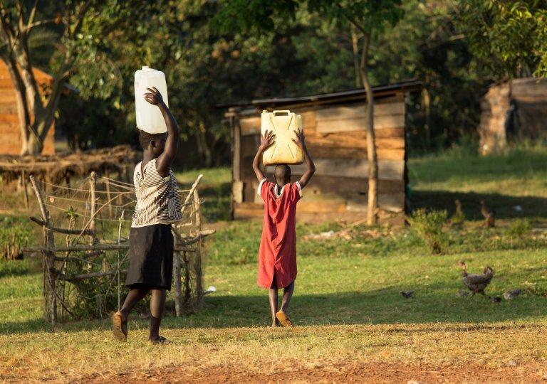 African children carrying water