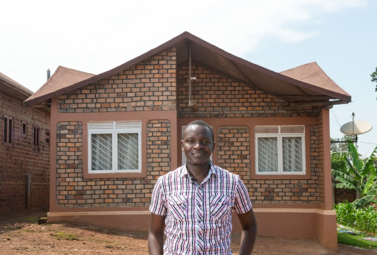 Andrew Amara outside his low cost home