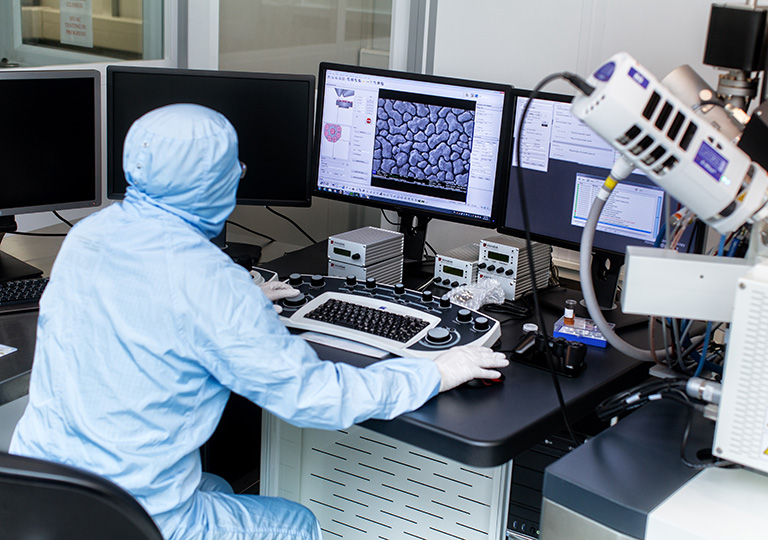 Researcher preparing graphene sample